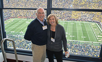 Peter and Carolyn Mertz attend a U-M football game