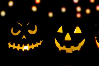 Glowing jack-o-lanterns in the night.